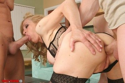 Sexually intrigued mature slut has some double penetration satisfaction with double young dicks