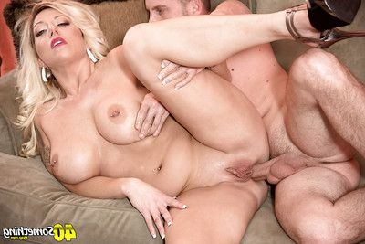 Mature blonde mother Ginger Black baring vast tits earlier than hardcore anal sex