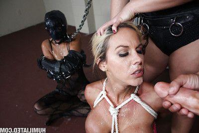MILF babes Kaylani and Layla have anal fucking action in bondage with bukkake