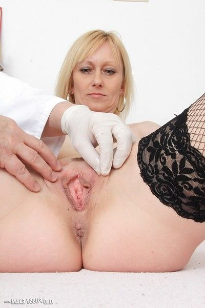 Aged blonde woman Nelly being examined by a kinky doctor