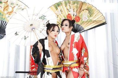 Sexy oriental MILFs Annie Cruz & Asa Akira posing with toys in their assholes
