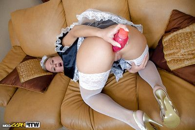 Foxy blonde maid in white stockings fascinating off her strings and toying her ass