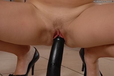 Curvy blonde MILF getting bottomless and stuffing her holes with a large dildo