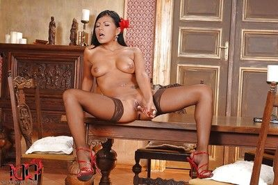 Steamy latina with permeated tit buttons and nylon clad legs toying her gash