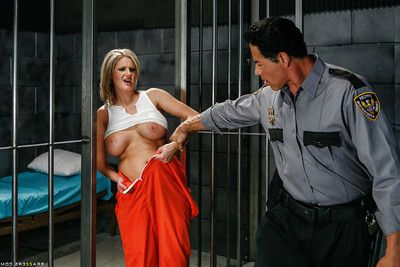Mature bitch with major tits Zoey Holiday is smoking in a prison uniform