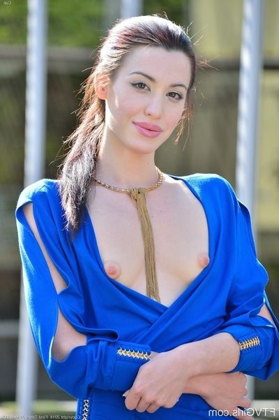 Slim brunette broad in a blue dress unveils her cleanly shaved fur pie