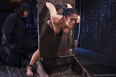 Eastern cutie Mia Li gets masturbated against her will on bondage table