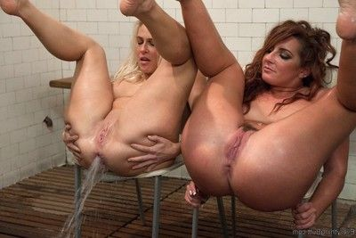 Mammoth butt lasses fisting enema squirting and huge strapon cock