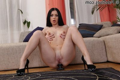 Unpitying brunette toys her ass with thick dildo
