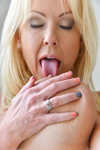Buxom blonde MILF spreads cunt for heavy dildo and bottle insertions