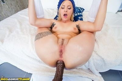 Tattooed blonde hotty obtains her holes fucked by a big brown pride