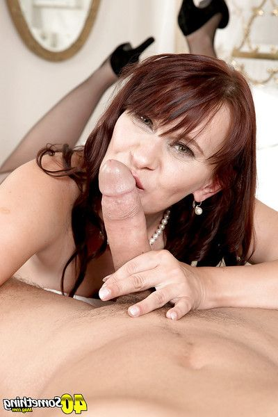 Mature woman in stocking freeing small pointer sisters from underclothes before giving bj