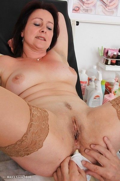 Ripe woman Simi strips and spreads cum-hole for checkup with gyno doctor