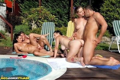 Stunning european harlots benefits from their holes boned-up at the pool groupsex party