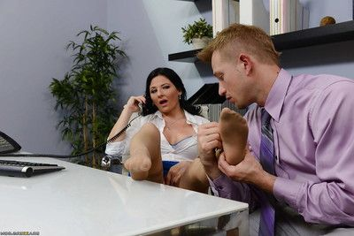Brunette boss lady Cassy Cumz receives oral pleasures while on telephone