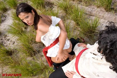 Bosomy brunette Angel Darkish covered in white and red takes hard fat cock in the long grass