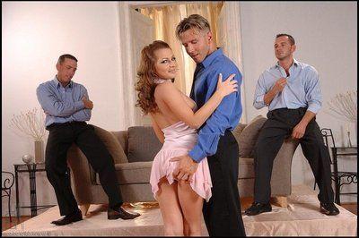 Two office gentlemen double penetrate slutty Jennifer Love and unload on her pretty face.