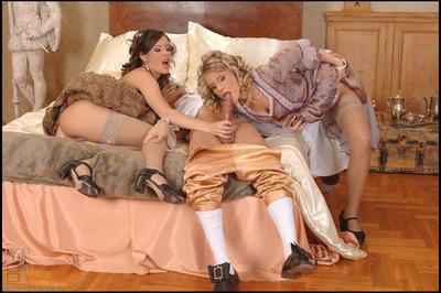 Vicious lesbian doll Lora Craft  and lewd Tiffany Rousso playing with long glass toy and their tongues.