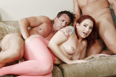 Tattooed redhead Sophia Locke getting spit-roasted by two large dongs