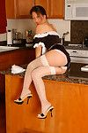 Teen Oriental female house slave strutting in kitchen in  and high heels