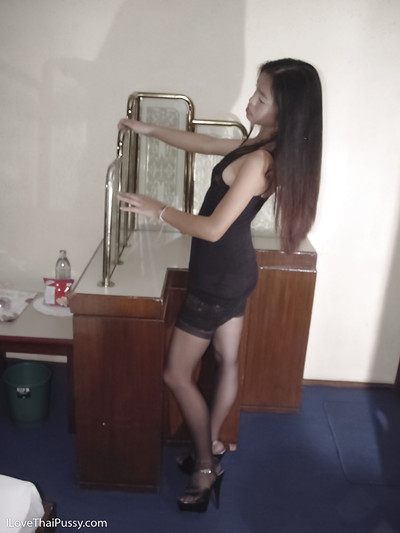 Untamed dark brown Thai pretty Fon swelling nylon clothing legs in high heels