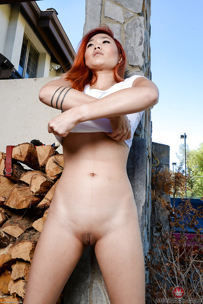 Redhead Eastern number one timer Lea Hart exposing hairless bawdy cleft outdoors