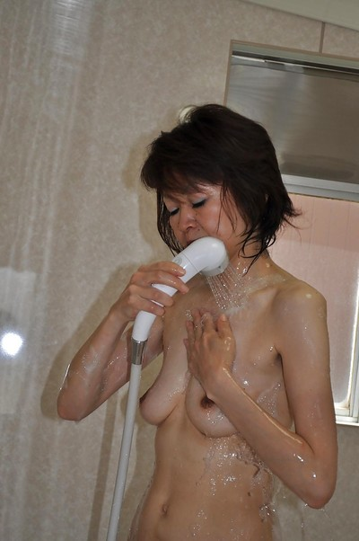 Diet mellow oriental hotty Takako Kumagaya pleasing shower-room and teasing her muff