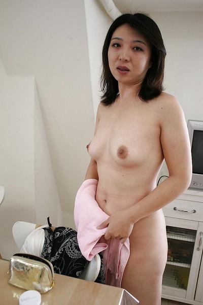 Exposed Japanese MILF Naho Tajiri turns to divulge her furry gash