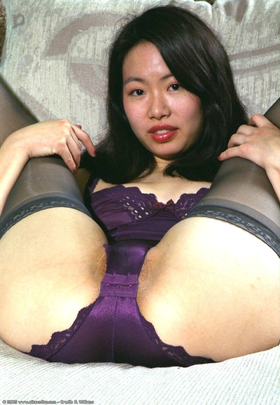 Adolescent Japanese pretty with compact pantoons stretching furry twat in
