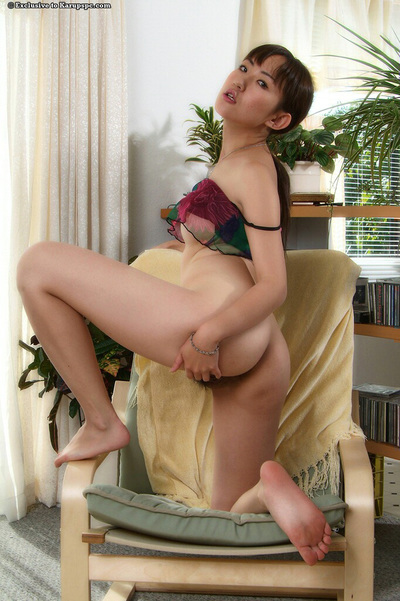 Oriental juvenile Kuki takes part in an juvenile close up posing scene