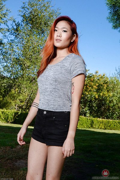 Redheaded Japanese youthful Lea Hart exposing excellent arse and love-cage outdoors