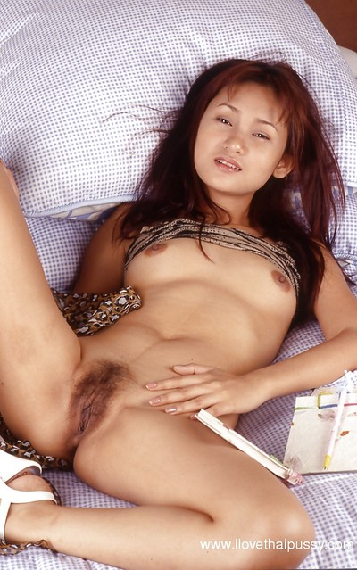 Japanese cutie in a posing scene, showing her hirsute uterus in high heels