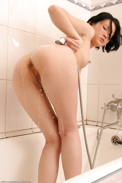 Lalin girl young Dia uses running shower-room water to stroke pussy lips with