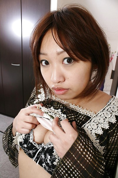 Eastern MILF Rika Okabe undressing and demonstrating her love-cage in close up