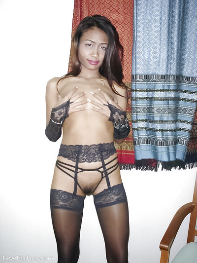 Slim Japanese adolescent darling with lean legs posing in brown nylons