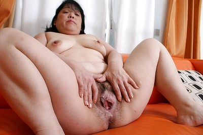 Unshaved uterus and fatty arse of a gorgeous Oriental Eiko Imamiya shown in close up