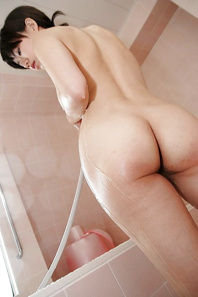 Willowy Chinese MILF entrancing bathroom and exposing her goods in close up