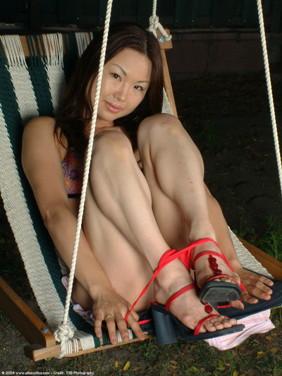 Teen Japanese model slipping off strings outdoors to reveal wavy cage of love