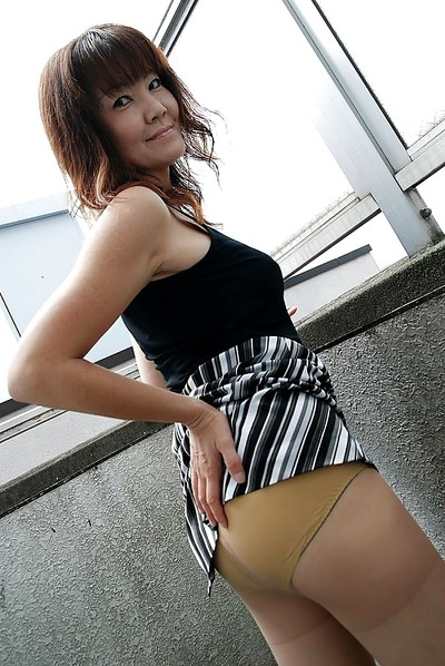 Chinese pretty Kimie Kuwata undressing and exposing her goods in close up