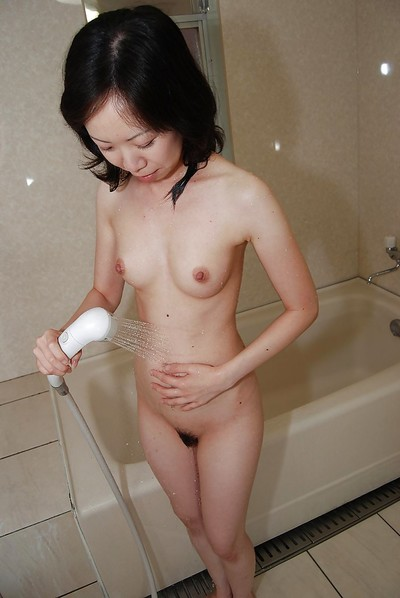 Lusty Japanese MILF with wavy fur pie gains owned and facialized exactly after baths