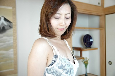 Chinese MILF Shiho Tanimura undressing and toying her unshaved gash
