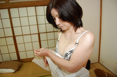 Sexual Chinese grown lassie getting without clothes and exposing her curly gash