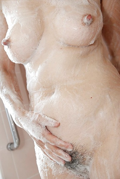 Oriental MILF Kimie Kuwata unveils her goods in close up despite the fact heavenly bath