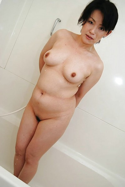 Chinese MILF Misuzu Masuko voluptuous bath and teasing her wavy muff
