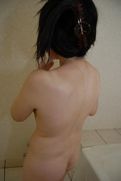 Lusty oriental infant engaging bathroom and rubbing her shaggy snatch in close up