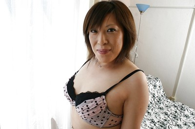 Japanese MILF in cylinder Kimiko Ogata erotic dancing off her clothing and underclothes Master