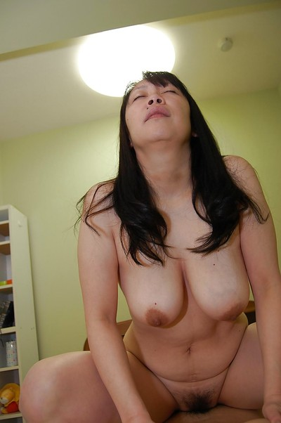 Concupiscent japanese MILF with large pantoons benefits from her unshaved bawdy cleft cocked up massive