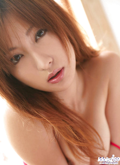Dazzling Japanese hottie revealing her diminutive bra buddies and hirsute cooter