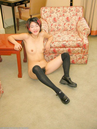 Juvenile Eastern in OTK stockings sheds underclothing to reveal hirsute snatch