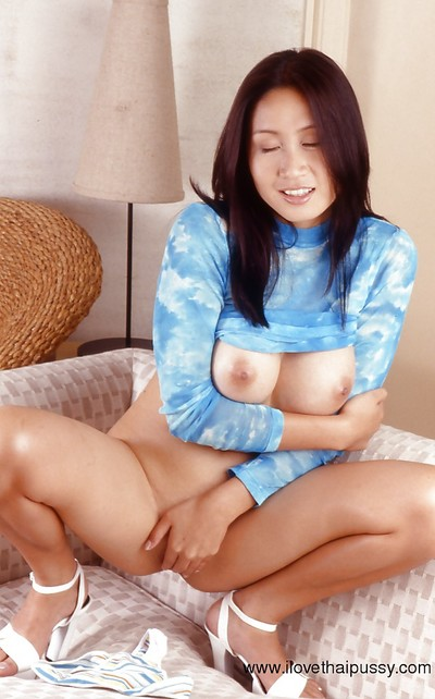 Stroking act lets slip wavy snatch and vast love melons of an Oriental cutie